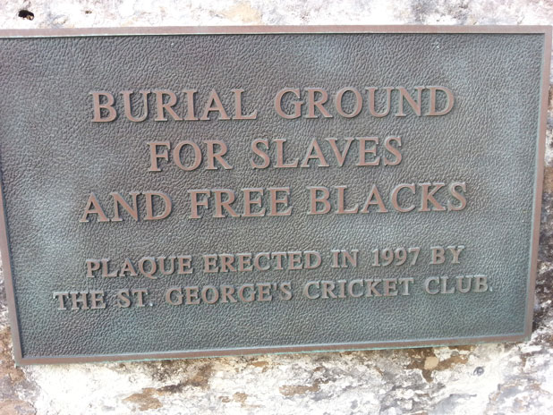 The placque at the entry to the lave and freed blacks cemetery. The placque reads, Burial Ground for Slaves and Free Blacks. Plaque Erected in 1997 by the St. George's Cricket Club