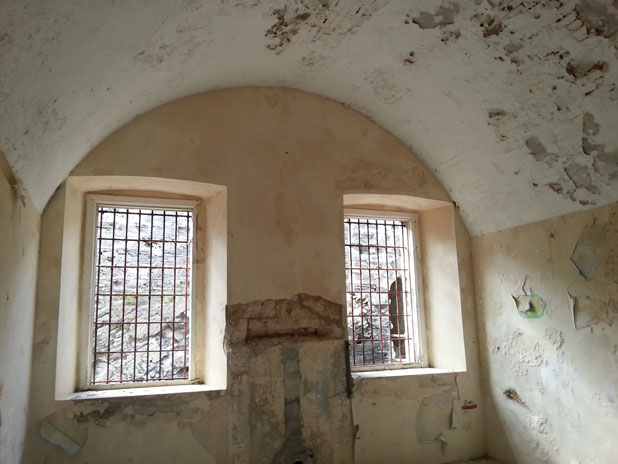 A cell in Casemates prison, made from limestone. There were never glass windows on this building.