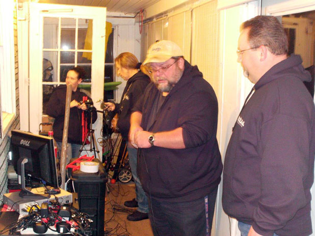 Kellie, Karen, Tom and Mike setting up for the investigation of the Merrill Family home