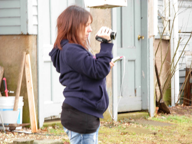 Kellie Gilbert investigates with a handheld camera